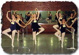 Intermediate and Advanced girls auditioning at the barre.
